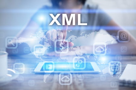 xml: Woman using tablet pc, pressing on virtual screen and selecting xml
