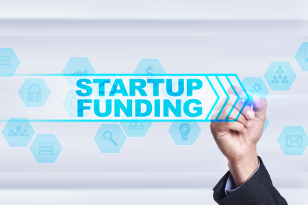 Businessman drawing on virtual screen. startup funding concept.