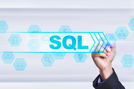Businessman drawing on virtual screen. sql concept.