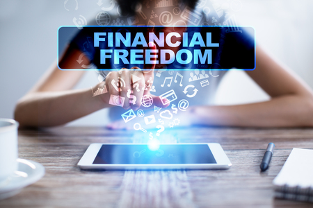debt goals: Woman using tablet pc, pressing on virtual screen and selecting financial freedom.