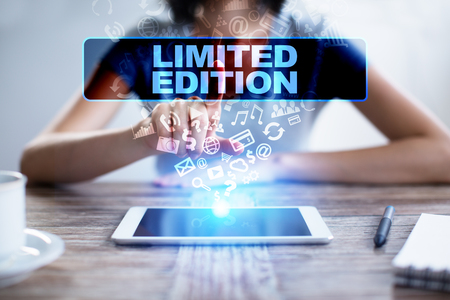 signed: Woman using tablet pc, pressing on virtual screen and selecting limited edition.