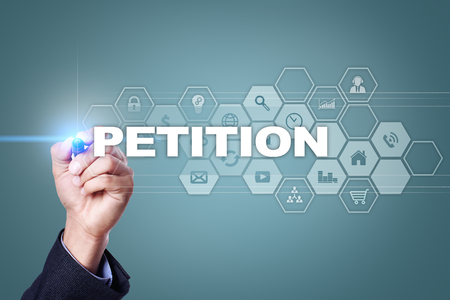 Businessman drawing on virtual screen. petition concept.