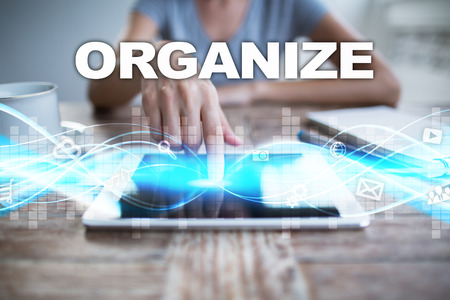 organised: Woman using tablet pc, pressing on virtual screen and selecting organize.