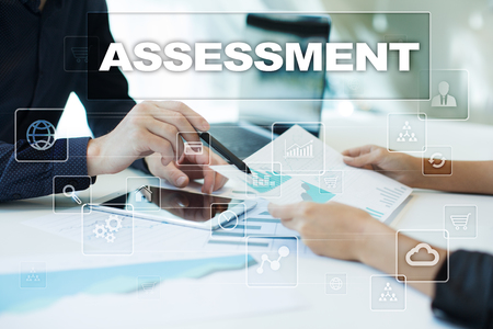 assessments: assessment on virtual screen. Business, technology and internet concept.