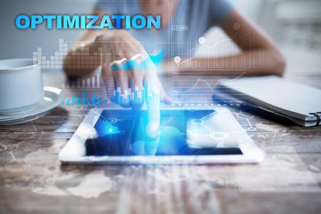 keyword: Woman using tablet pc, pressing on virtual screen and selecting optimization.