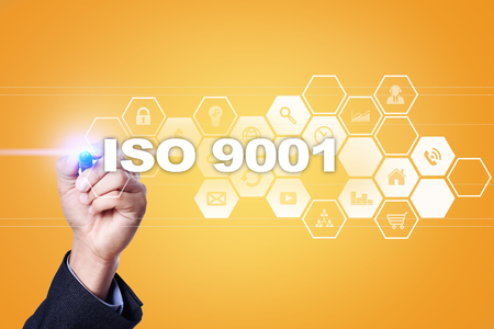 Businessman drawing on virtual screen. iso 9001 concept.