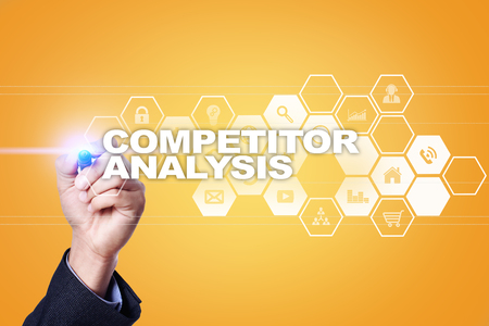 Businessman drawing on virtual screen. competitor analysis concept.