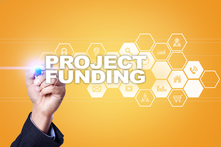 grants: Businessman drawing on virtual screen. project funding concept. Stock Photo