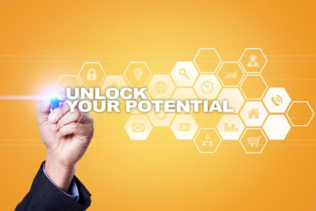 Businessman drawing on virtual screen. unlock your potential concept.