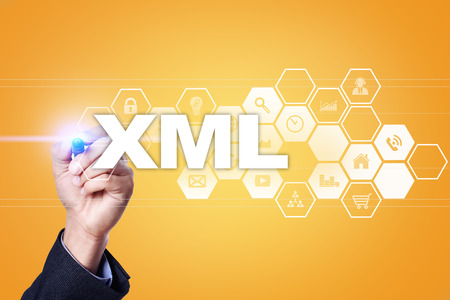 xml: Businessman drawing on virtual screen. xml concept. Stock Photo