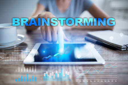 using tablet: Woman using tablet pc, pressing on virtual screen and selecting brainstorming.