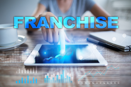 franchising: Woman using tablet pc, pressing on virtual screen and selecting franchise.