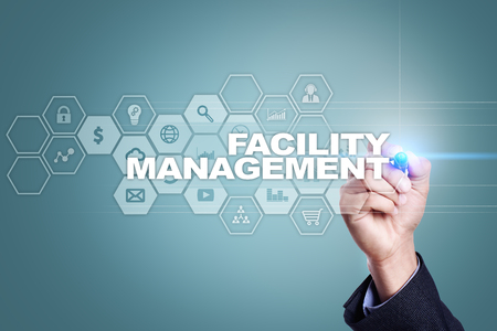 property management: Businessman drawing on virtual screen. facility management concept. Stock Photo