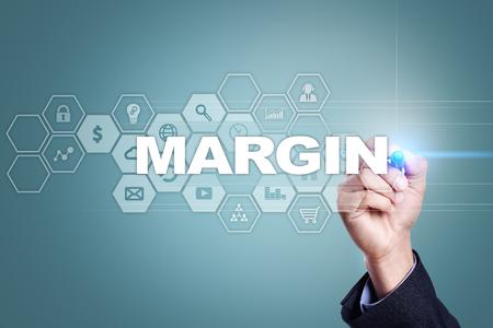 marginal: Businessman drawing on virtual screen. margin concept.