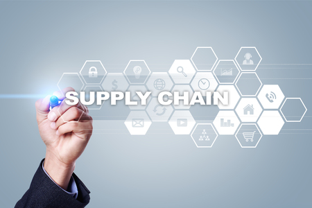 Businessman drawing on virtual screen. supply chain concept.