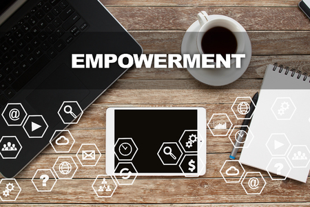 enabling: Tablet on desktop with empowerment text.