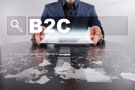 Businessman working with modern tablet PC and presenting b2c concept. Stock Photo