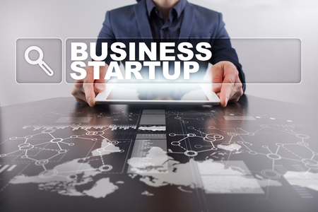 investor: Businessman working with modern tablet PC and presenting business startup concept. Stock Photo