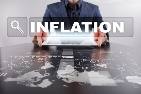 Businessman working with modern tablet PC and presenting inflation concept.