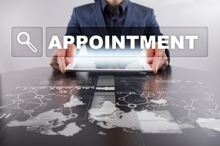 Businessman working with modern tablet PC and presenting appointment concept. Stock Photo