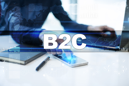 Businessman working in office, pressing button on virtual screen and selecting b2c.