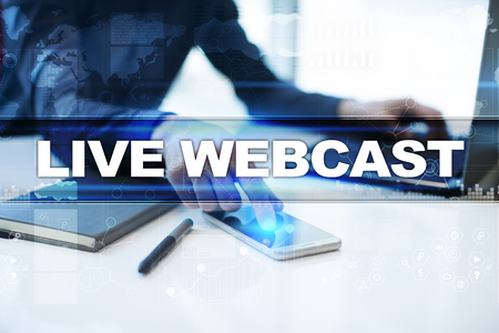 live stream radio: Businessman working in office, pressing button on virtual screen and selecting live webcast. Stock Photo