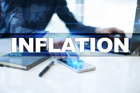 Businessman working in office, pressing button on virtual screen and selecting inflation. Imagens