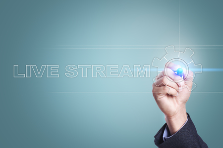 Businessman drawing on virtual screen. live stream concept. Stock Photo