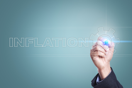 Businessman drawing on virtual screen. inflation concept.