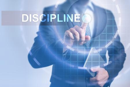 disciplined: Businessman selecting discipline on virtual screen. Stock Photo