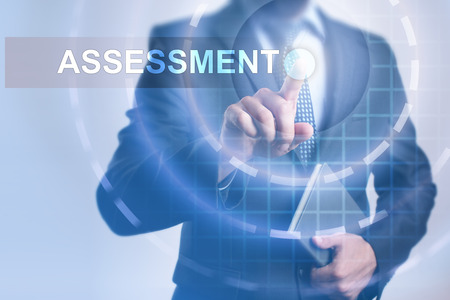assessments: Businessman selecting assessment on virtual screen.