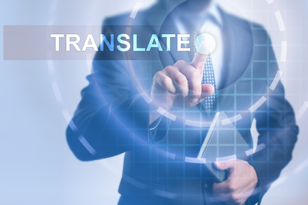 Businessman selecting translate on virtual screen.