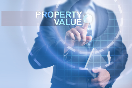 Businessman selecting property value on virtual screen.
