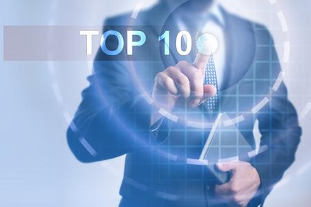 사업가 가상 스크린에 상위 10를 선택합니다. 스톡 콘텐츠 - 79382663