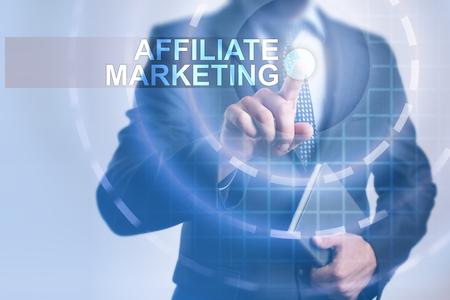 Businessman selecting affiliate marketing on virtual screen.