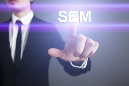 adwords: Businessman selecting sem on virtual screen. Stock Photo