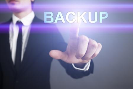 Businessman selecting backup on virtual screen.