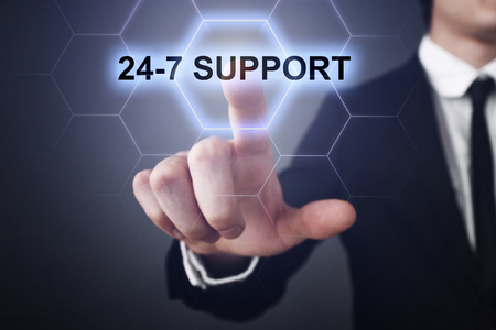 24x7: Businessman selecting 24-7 support on virtual screen.
