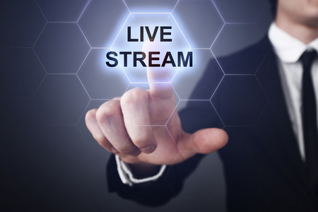 live stream radio: Businessman selecting live stream on virtual screen.