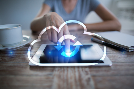 using tablet: Cloud technology. Data storage. Networking and internet service concept.
