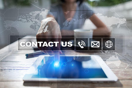 Contact us button and text on virtual screen. Business and technology concept. 스톡 콘텐츠
