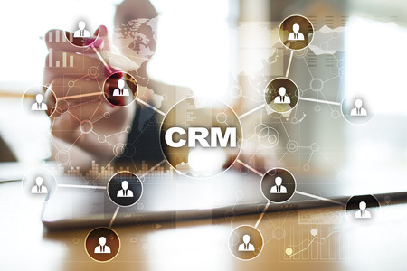 pressing: CRM. Customer relationship management concept. Customer service and relationship. Stock Photo