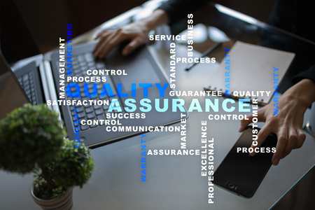 assured: Quality assurance concept on the virtual screen. Business concept. Words cloud. Stock Photo