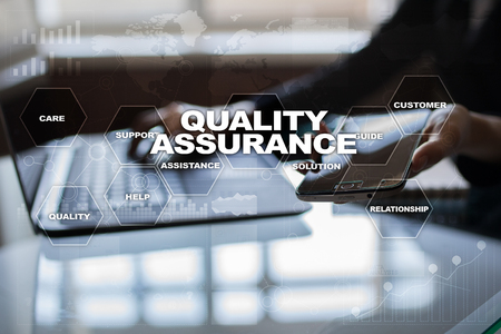 Quality assurance concept on the virtual screen. Business concept. Stockfoto
