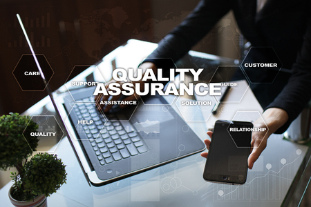 assured: Quality assurance concept on the virtual screen. Business concept. Stock Photo