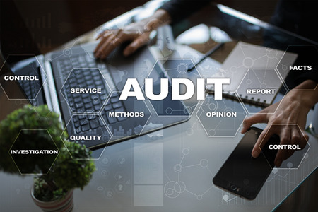 Audit business concept. Auditor. Compliance. Virtual screen technology. Stock Photo