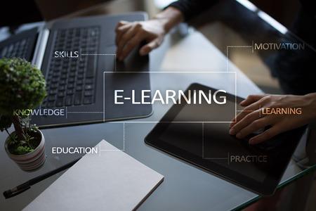 E-Learning on the virtual screen. Internet education concept. Archivio Fotografico