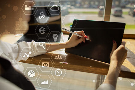 Business and technology concept. Graphs and icons on virtual screen. Stock Photo
