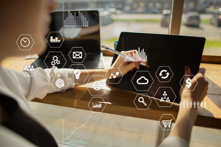 Business and technology concept. Graphs and icons on virtual screen background.