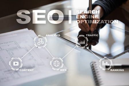 screen: SEO. Search Engine optimization. Digital online marketing and Internet technology concept.